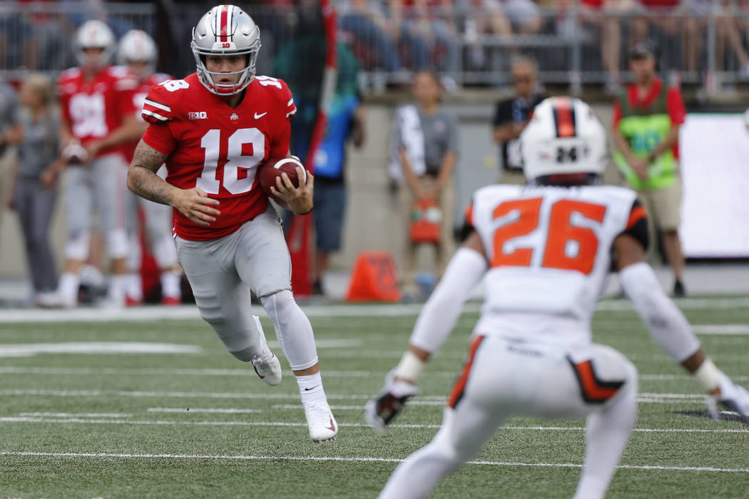 Ohio State quarterback Tate Martell plays against Oregon State during an NCAA college football game Saturday, Sept. 1, 2018, in Columbus, Ohio. (AP Photo/Jay LaPrete)