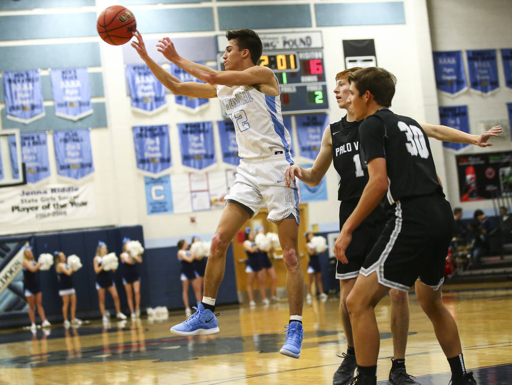 Centennial's Austin Anderson (12) passes the ball in front of Palo Verde's Connor Peterson (1) during the first half of a basketball game at Centennial Hills High School in Las Vegas on Friday, Ja ...