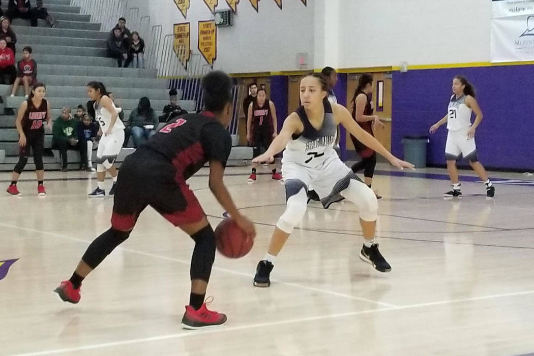 Spring Valley's Garrisen Freeman, right, defends Liberty's Joy Watkins on Saturday against Liberty during the Battle Born Classic at Durango High. The Grizzlies defeated the Patriots, 37-28. (Damo ...