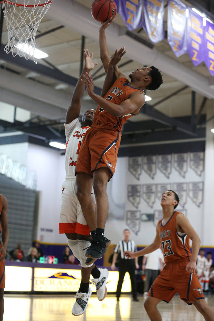 Legacy's Jalen Johnson (5) goes up for a shot against Chaparral's Meshach Hawkins (1) in the boy's basketball game at Durango High School in Las Vegas, Saturday, Jan. 12, 2019. Erik Verduzco Las V ...