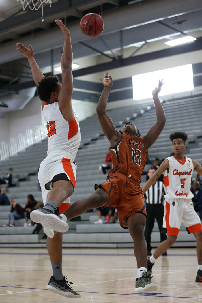 Legacy's Aaron Holloway (13) takes a shot as he is fouled by Chaparral's Iopu Tauli'ili (12) in the boy's basketball game at Durango High School in Las Vegas, Saturday, Jan. 12, 2019. Erik Verduzc ...