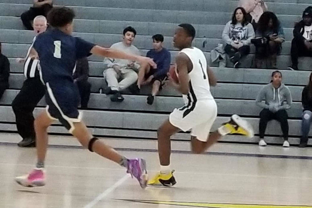 Democracy Prep's Najeeb Muhammad, right, pushes the ball down the floor against Bonita Vista (California) Saturday during the Battle Born Classic at Durango High. Democracy Prep won, 63-51.