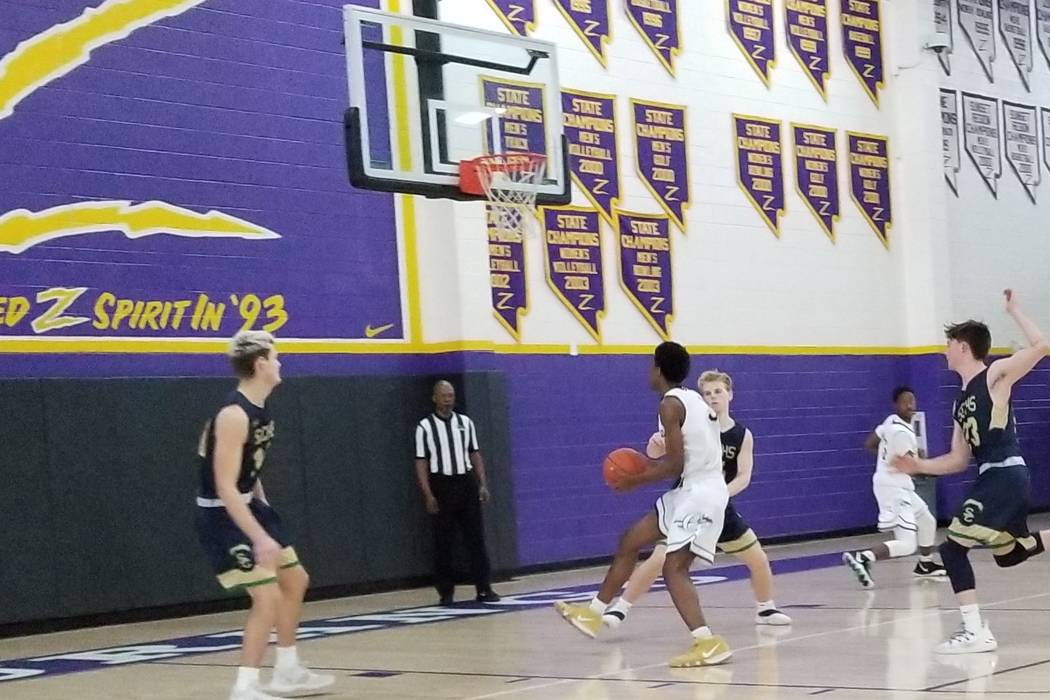 Cheyenne's Glenn Taylor drives to the basket against Snow Canyon (Utah) on Saturday during the Battle Born Classic at Durango High. Taylor had 16 points and Cheyenne won 49-36. (Damon Seiters/Las ...