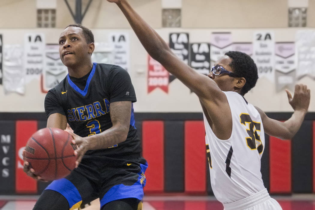 Sierra Vista senior Calvin Richards (3) drives past Bonanza senior Ian White (35) in the first quarter during the semifinals of the Vegas Invitational boys basketball tournament on Friday, Jan. 4, ...