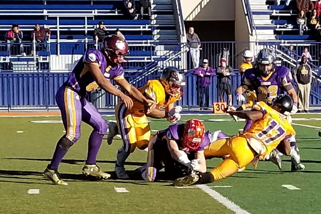 The South's Isaiah Veal (17) of Clark is brought down on a kickoff return during the the 47th West Charleston Lions Charity all-star game on Sunday, Jan. 13, 2019 at Bishop Gorman. (Damon Seiters/ ...