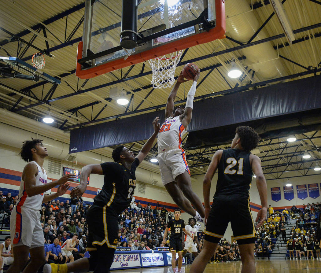Bishop Gorman's Mwani Wilkinson (23) goes to shoot the ball while under pressure from Clark's Antwon Jackson (23) during the second half of a basketball game at Bishop Gorman High School in Las Ve ...