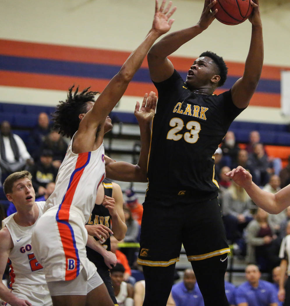 Clark's Antwon Jackson (23) goes to shoot the ball while under pressure from Bishop Gorman's Isaiah Cottrell (0) during the first half of a basketball game at Bishop Gorman High School in Las Vega ...