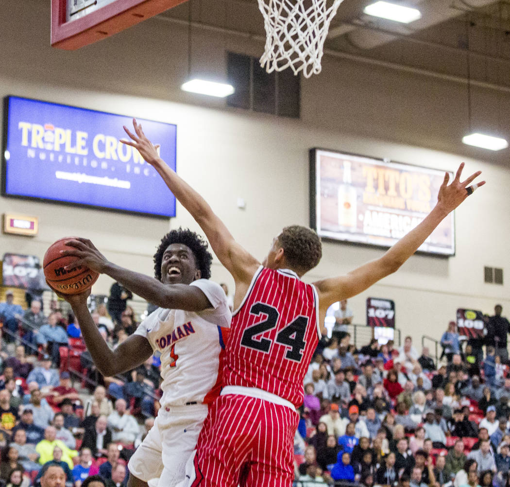 Bishop Gorman's Will McClendon (1) looks to shoot while Findlay Prep's Spencer Washington (24) looks to block him during the Big City Showdown at South Point in Las Vegas on Saturday, Jan. 20, 201 ...