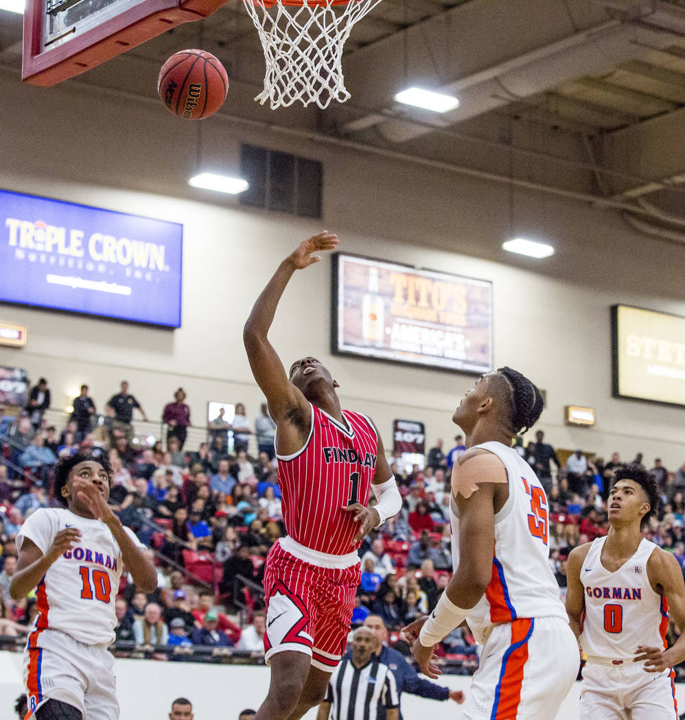 Findlay Prep's TJ Moss (1) lobs the ball toward the hoop as Bishop Gorman's Zaon Collins (1), Jamal Bey (35) and Isaiah Cottrell (0) watch during the Big City Showdown at South Point in Las Vegas ...