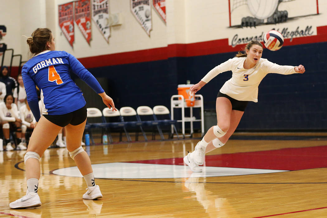 Bishop Gorman's Tommi Stockham (3) reaches for a save against Palo Verde during the third set of the girl's volleyball game at Coronado High School in Henderson, Saturday, Nov. 3, 2018. Bishop Gor ...