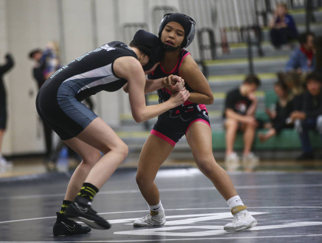 SLAM Academy's Sterling Dias, right, wrestles against Palo Verde's Faith Call during a match at Palo Verde High School in Las Vegas on Wednesday, Jan. 16, 2019. Chase Stevens Las Vegas Review-Jour ...