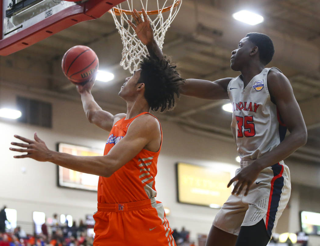 Bishop Gorman's Isaiah Cottrell goes to the basket in front of Findlay Prep's Alex Tchikou (35) during the first half of the annual Big City Showdown basketball game at the South Point in Las Vega ...