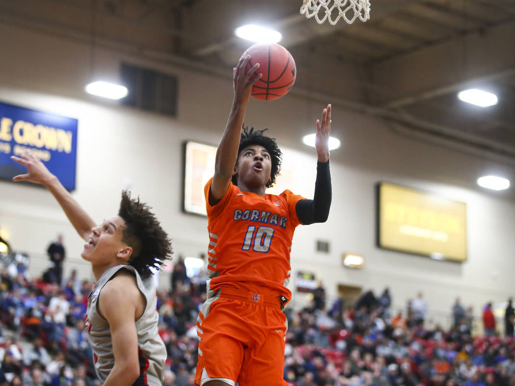 Bishop Gorman's Zaon Collins (10) goes to the basket in front of Findlay Prep's Blaise Beauchamp during the first half of the annual Big City Showdown basketball game at the South Point in Las Veg ...