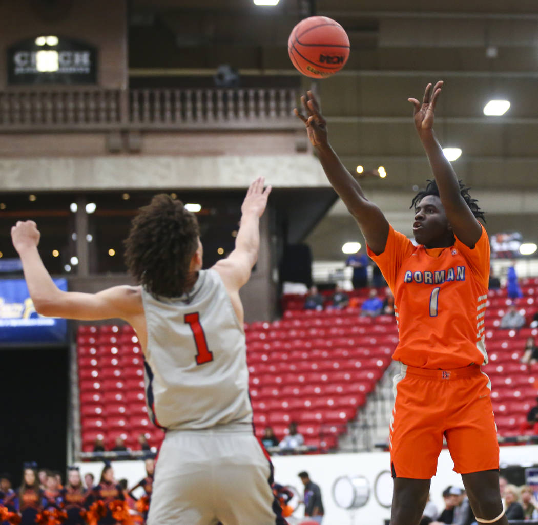 Bishop Gorman's Will McClendon (1) shoots over Findlay Prep's Blaise Beauchamp (1) during the first half of the annual Big City Showdown basketball game at the South Point in Las Vegas on Saturday ...