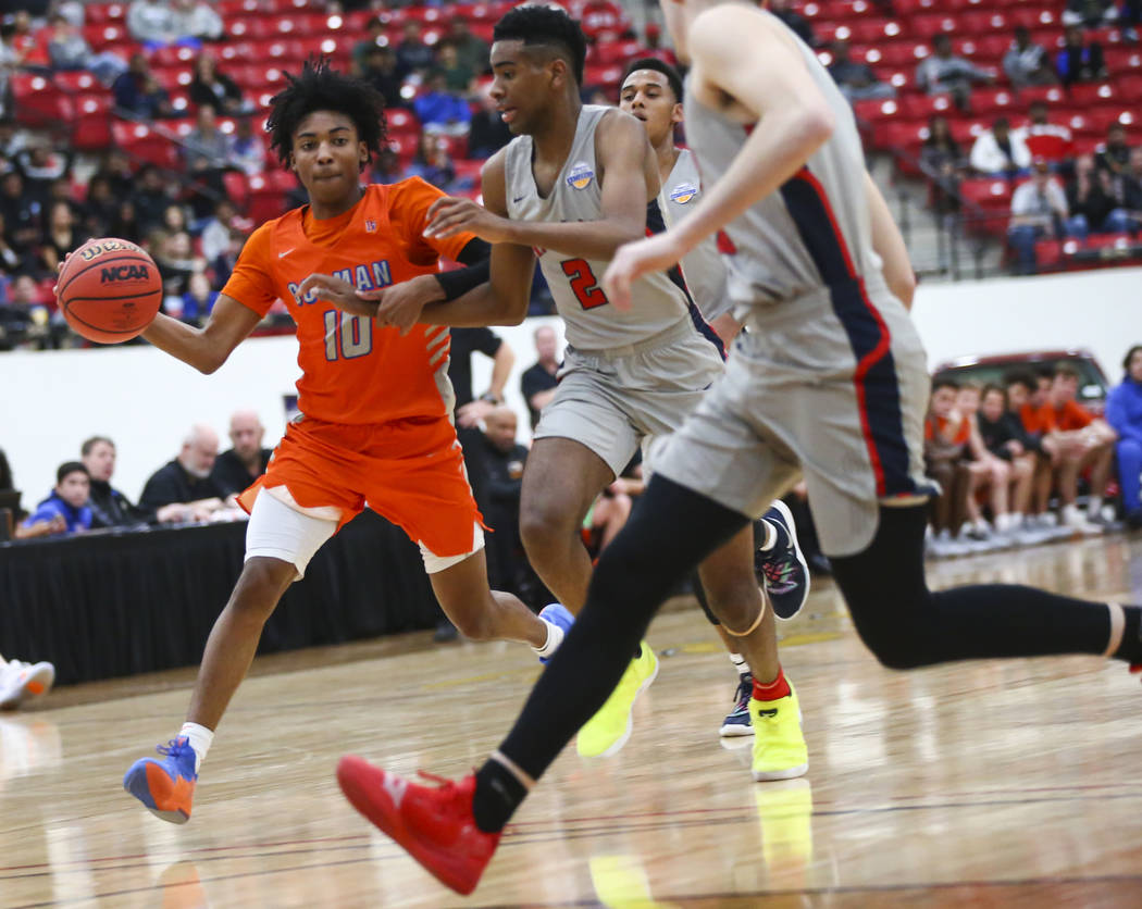 Bishop Gorman's Zaon Collins (10) drives the ball against Findlay Prep's Aston Smith (2) during the first half of the annual Big City Showdown basketball game at the South Point in Las Vegas on Sa ...