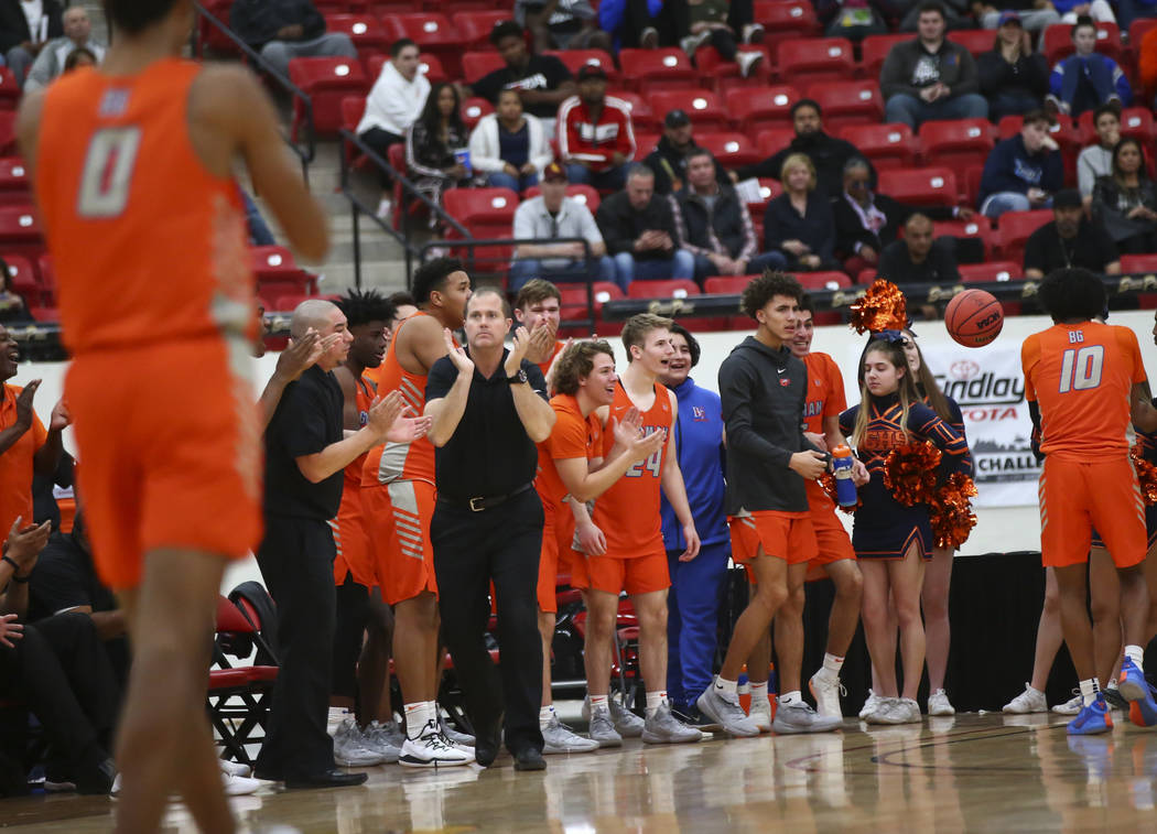 Bishop Gorman head coach Grant Rice, center left in black, celebrates as his team leads against Findlay Prep in the second half of the annual Big City Showdown basketball game at the South Point i ...