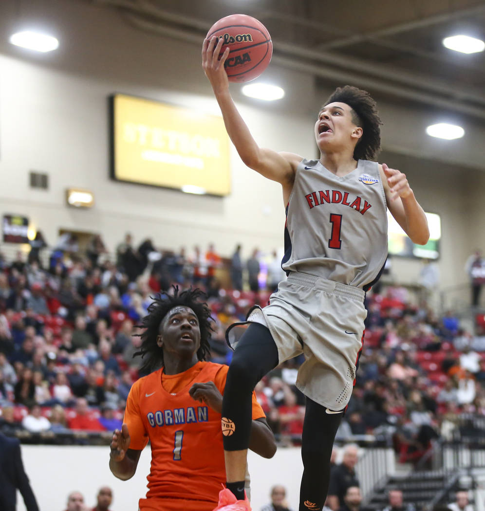 Findlay Prep's Blaise Beauchamp (1) goes to the basket over Bishop Gorman's Will McClendon (1) during the second half of the annual Big City Showdown basketball game at the South Point in Las Vega ...