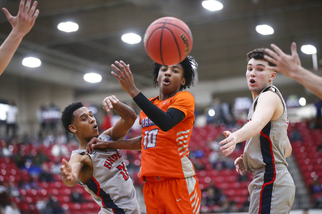Bishop Gorman's Zaon Collins (10) watches a loose ball between Findlay Prep's Taryn Todd (11) and Connor Murphy during the first half of the annual Big City Showdown basketball game at the South P ...
