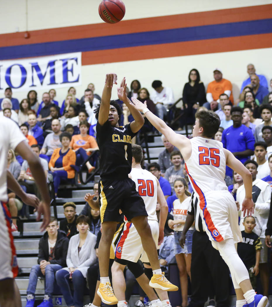 Clark's Frankie Collins (1) shoots over Bishop Gorman's Chance Michels (25) during a basketball game at Bishop Gorman High School in Las Vegas on Friday, Feb. 9, 2018. Chase Stevens Las Vegas Revi ...