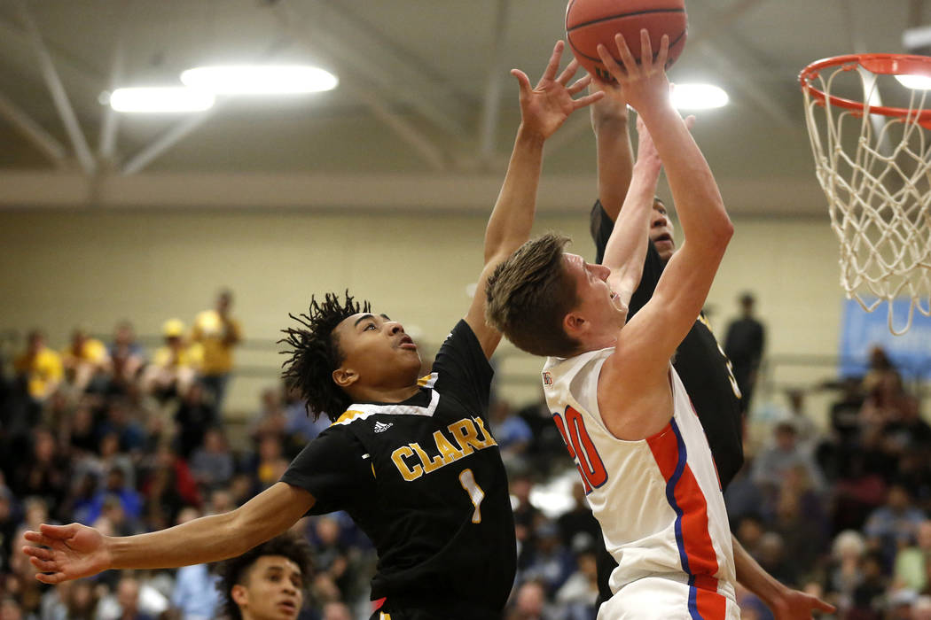 Bishop Gorman's Noah Taitz (20) shoots against Clark's Frankie Collins (1) during the Sunset Region boys basketball championship at Legacy High School in North Las Vegas on Saturday, Feb. 17, 201 ...