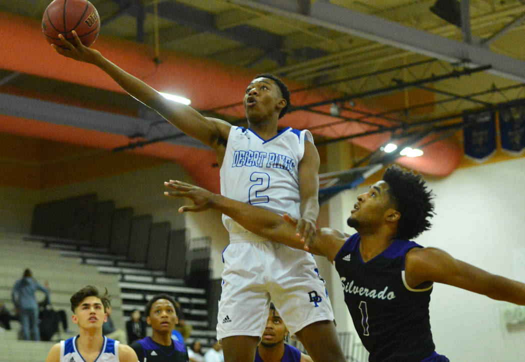 Desert Pines' Dayshawn Wiley (2) takes a shot over Silverado's Leandrew Menefee (1) in the first quarter of the Desert Pines vs. Silverado High School basketball game at Desert Pines High School i ...