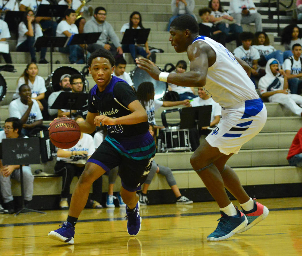 Silverado's Damion Byrd II (20) dribbles the ball down the baseline in the third quarter of the Desert Pines vs. Silverado High School basketball game at Desert Pines High School in Las Vegas on M ...