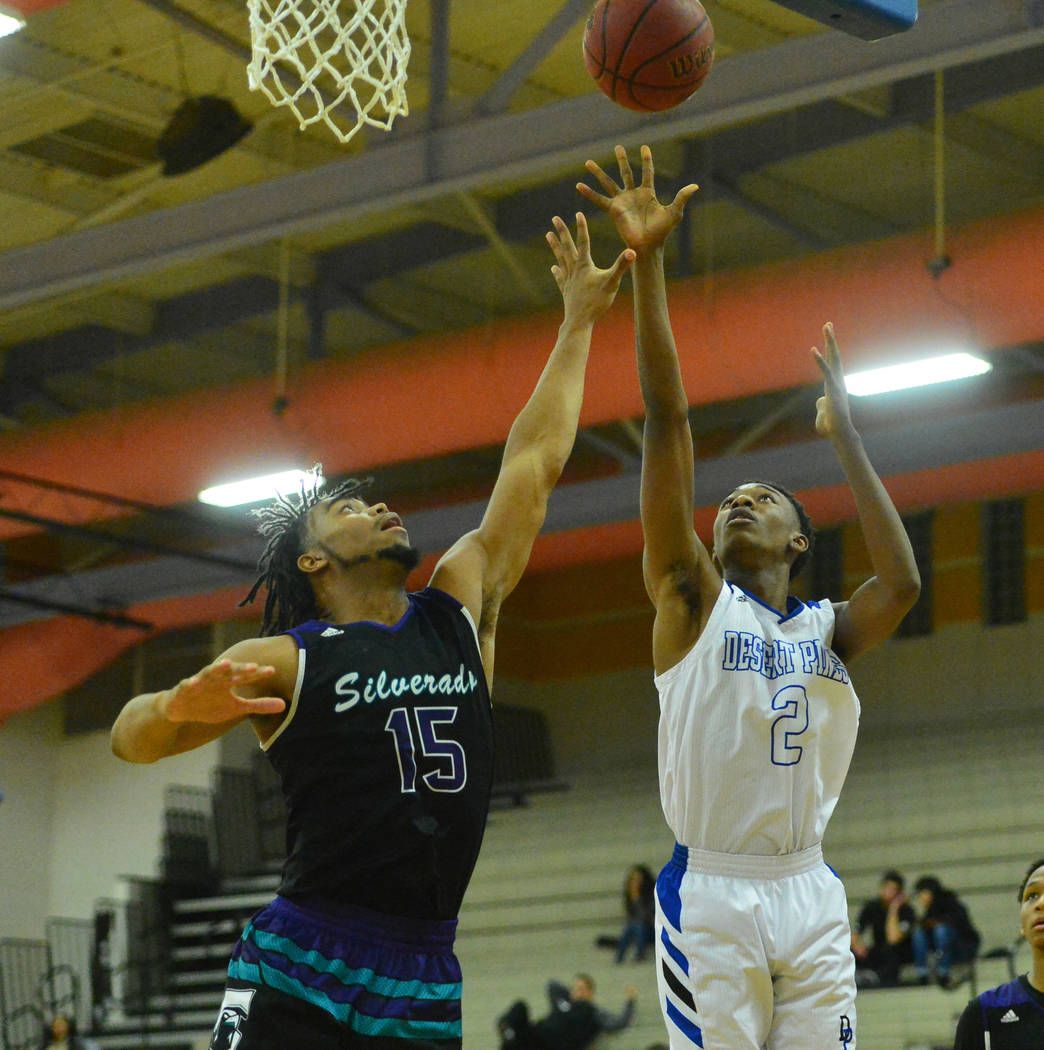 Desert Pines' Dayshawn Wiley (2) takes a shot over Silverado's Martel Williams (15) in the third quarter of the Desert Pines vs. Silverado High School basketball game at Desert Pines High School i ...