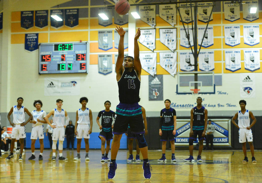 Silverado's Martell Williams (15) takes free throws after a technical foul in the fourth quarter of the Desert Pines vs. Silverado High School basketball game at Desert Pines High School in Las Ve ...