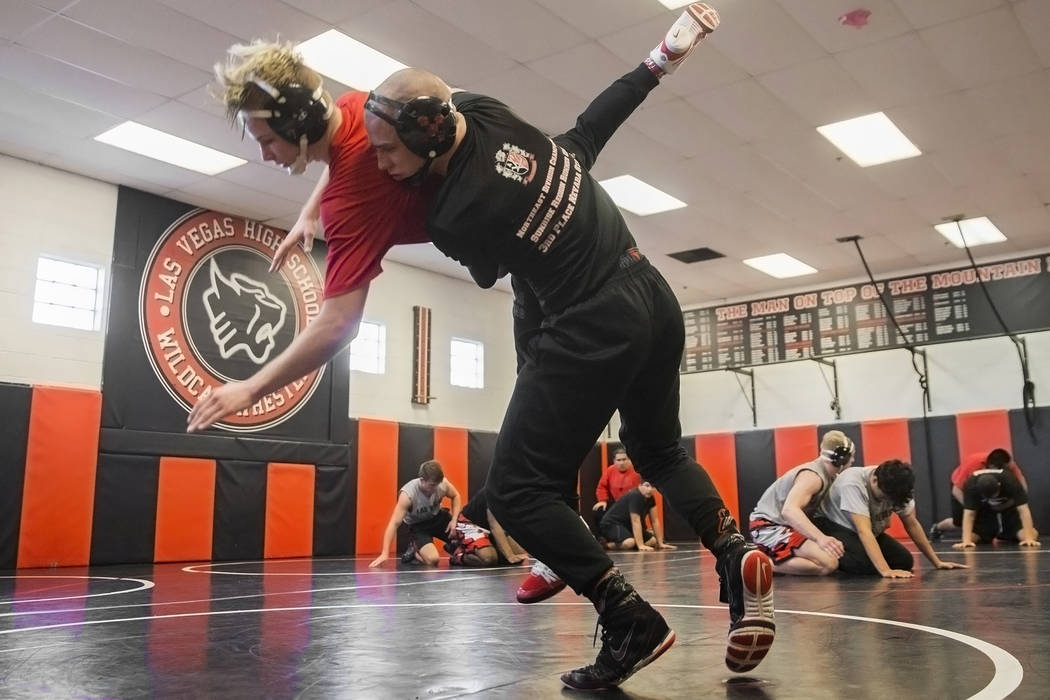 Daniel Law, right, lifts Trace Everett during wrestling practice on Friday, Jan. 25, 2019, at Las Vegas High School, in Las Vegas. (Benjamin Hager/Las Vegas Review-Journal) @BenjaminHphoto