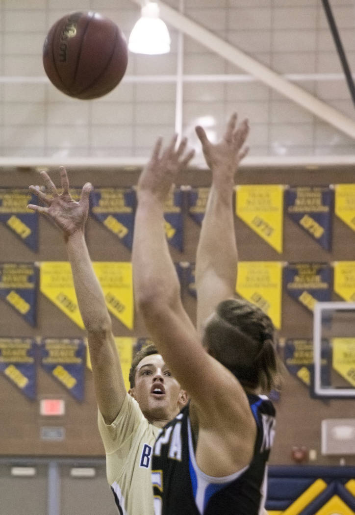 Boulder City senior guard Karson Bailey (14) shoots over Moapa Valley senior forward Jessup Lake (15) in the first quarter on Tuesday, Jan. 29, 2019, at Boulder City High School, in Las Vegas. (Be ...