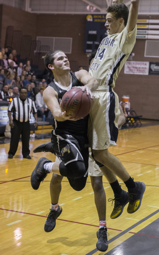 Moapa Valley senior guard Chase Hoy (2) drives baseline past Boulder City senior guard Karson Bailey (14) in the second quarter on Tuesday, Jan. 29, 2019, at Boulder City High School, in Las Vega ...