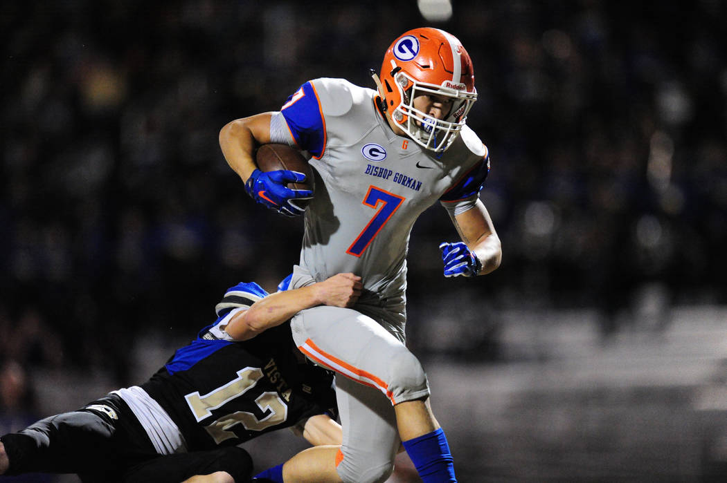 Bishop Gorman running back Biaggio Ali Walsh scores a touchdown despite being wrapped up by Sierra Vista cornerback Trevor Gentner in the first half of their prep football game at Sierra Vista Hig ...