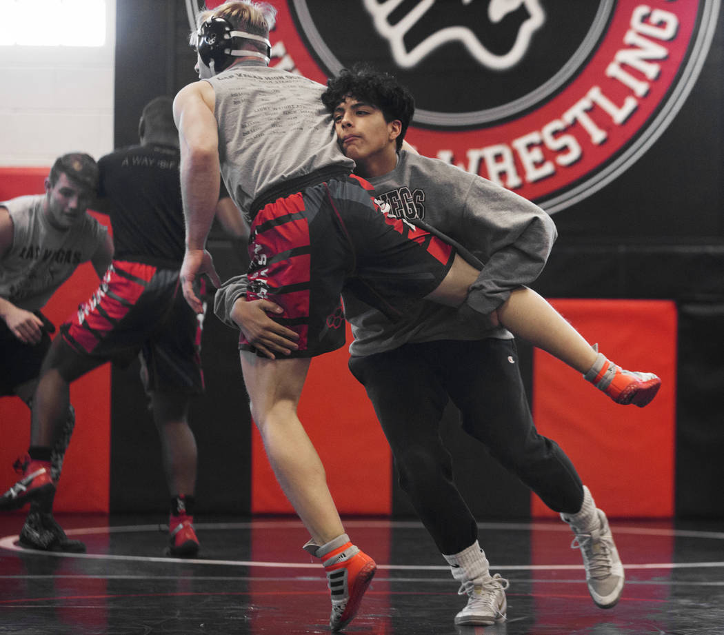 Jakob Alvarado, right, and Caleb Roach work through drills during wrestling practice on Friday, Jan. 25, 2019, at Las Vegas High School, in Las Vegas. (Benjamin Hager/Las Vegas Review-Journal) @Be ...