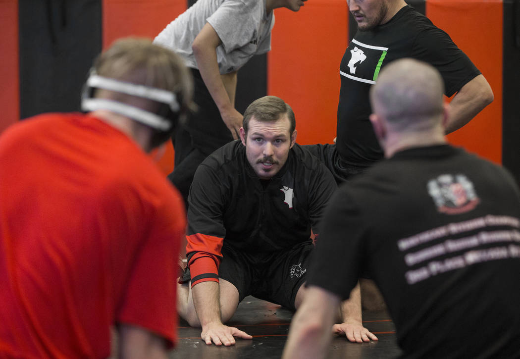 Coach Zach Hocker, middle, gives direction during wrestling practice on Friday, Jan. 25, 2019, at Las Vegas High School, in Las Vegas. (Benjamin Hager/Las Vegas Review-Journal) @BenjaminHphoto