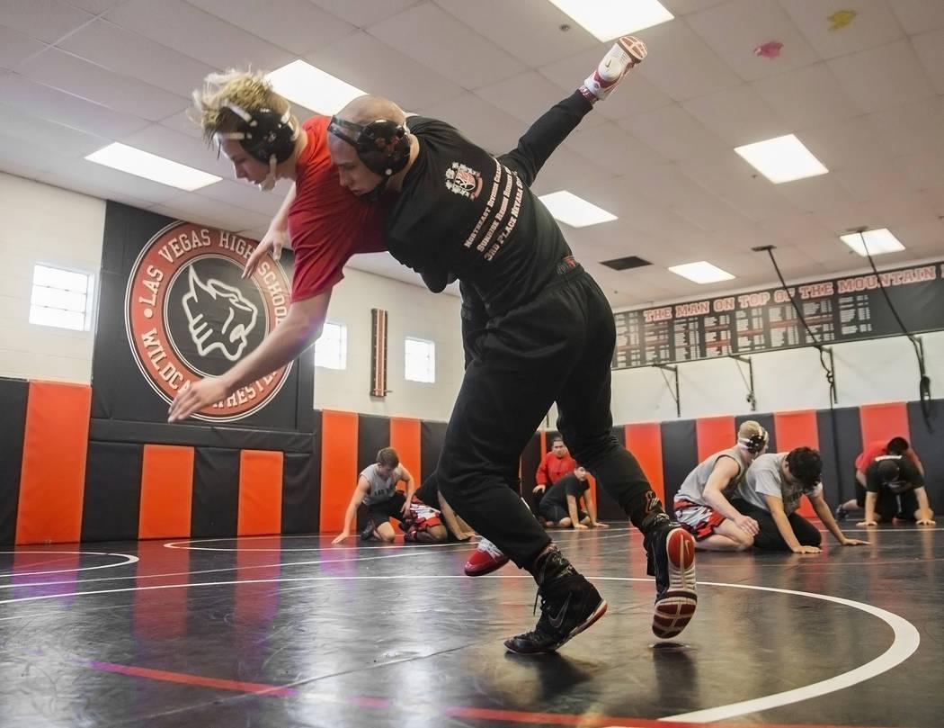 Daniel Law, right, lifts Trace Everett during wrestling practice on Friday, Jan. 25, 2019, at Las Vegas High School, in Las Vegas. (Benjamin Hager/Las Vegas Review-Journal) @BenjaminHphoto