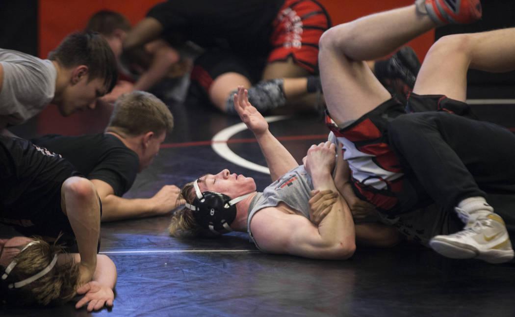 Caleb Roach, middle, works through a drill during wrestling practice on Friday, Jan. 25, 2019, at Las Vegas High School, in Las Vegas. (Benjamin Hager/Las Vegas Review-Journal) @BenjaminHphoto