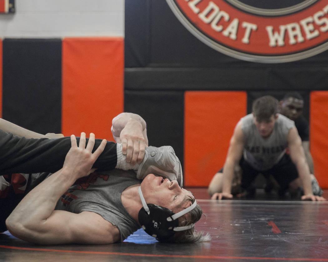 Caleb Roach, left, works through a drill during wrestling practice on Friday, Jan. 25, 2019, at Las Vegas High School, in Las Vegas. (Benjamin Hager/Las Vegas Review-Journal) @BenjaminHphoto