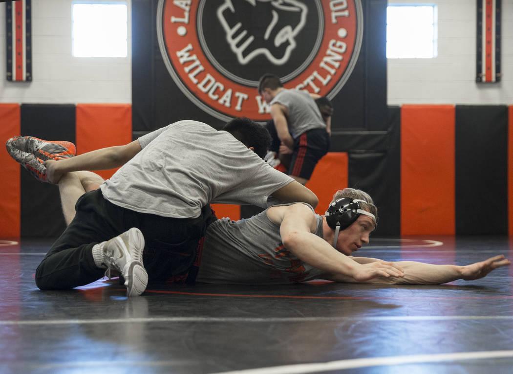 Caleb Roach, right/bottom, and Jakob Alvarado work through drills during wrestling practice on Friday, Jan. 25, 2019, at Las Vegas High School, in Las Vegas. (Benjamin Hager/Las Vegas Review-Journ ...