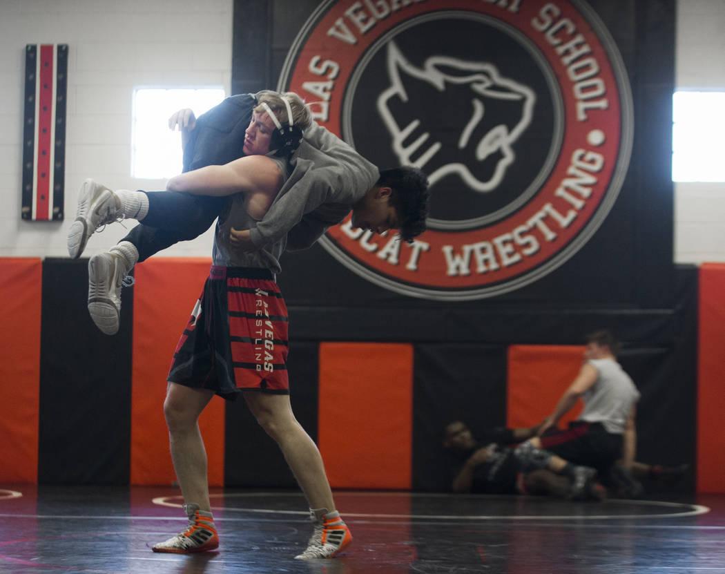 Caleb Roach, left/top, lifts Jakob Alvarado during wrestling practice on Friday, Jan. 25, 2019, at Las Vegas High School, in Las Vegas. (Benjamin Hager/Las Vegas Review-Journal) @BenjaminHphoto