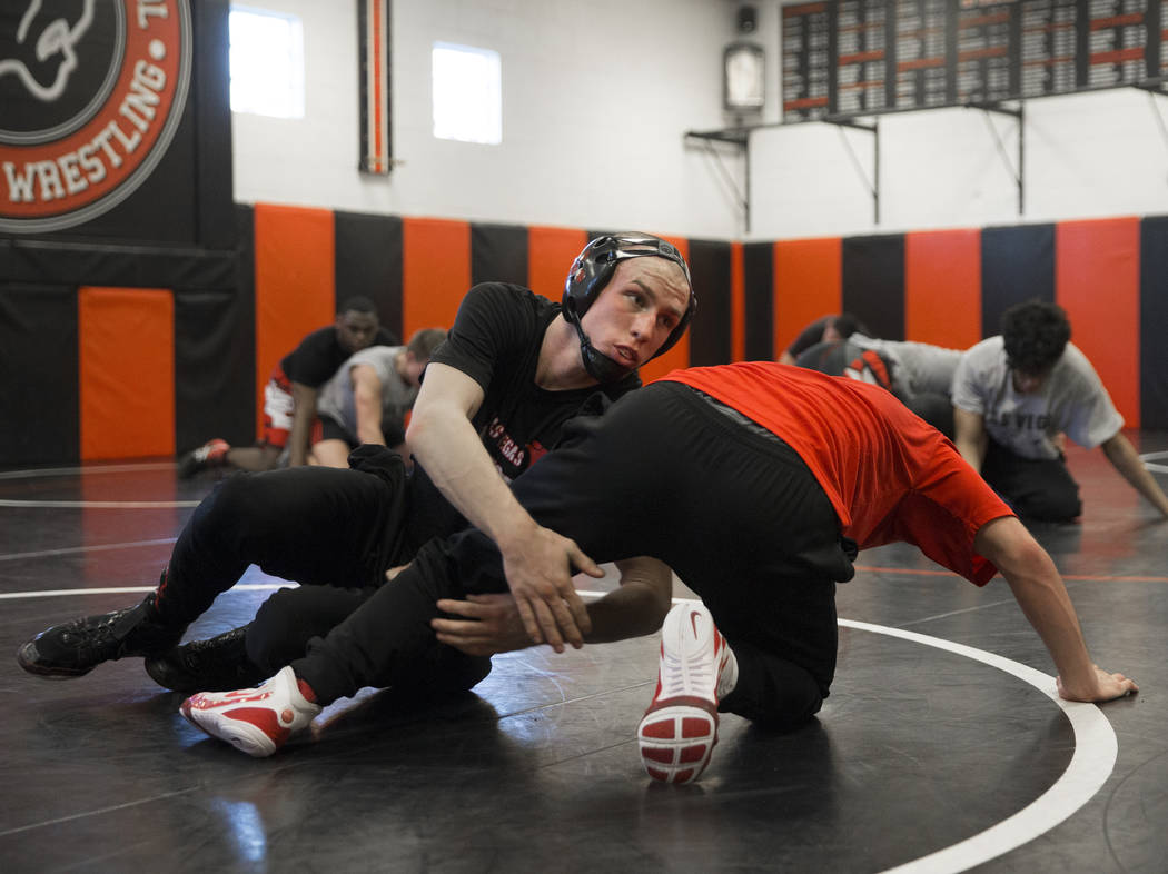 Daniel Law, left, fights for position with teammate Trace Everett during wrestling practice on Friday, Jan. 25, 2019, at Las Vegas High School, in Las Vegas. (Benjamin Hager/Las Vegas Review-Journ ...