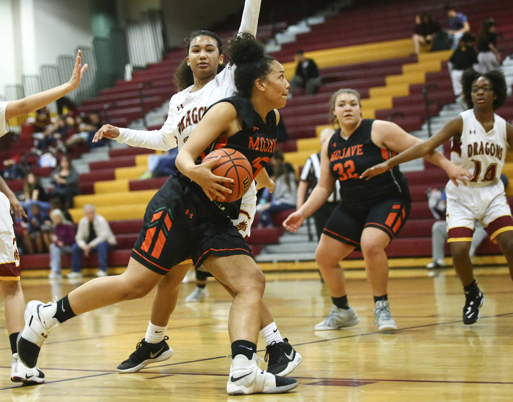 Mojave's Chania Scott (25) drives to the basket pagainst Del Sol's Paige Birch during the second half of a basketball game at Del Sol High School in Las Vegas on Wednesday, Jan. 30, 2019. (Chase S ...