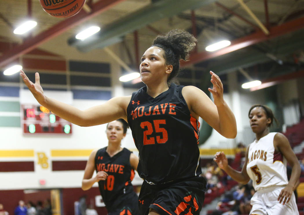 Mojave's Chania Scott (25) goes after a loose ball during the second half of a basketball game at Del Sol High School in Las Vegas on Wednesday, Jan. 30, 2019. (Chase Stevens/Las Vegas Review-Jour ...
