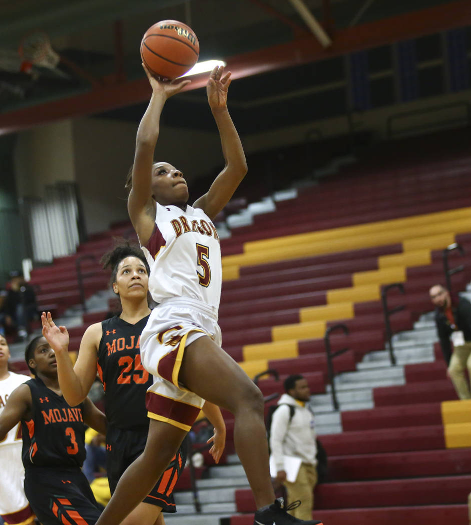 Del Sol's Markay Merchant (5) goes to the basket past Mojave's Chania Scott (25) during the first half of a basketball game at Del Sol High School in Las Vegas on Wednesday, Jan. 30, 2019. (Chase ...