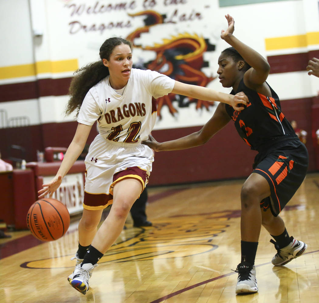 Del Sol's Christelle Jones (22) drives past Mojave's Jaiden Rogers (3) during the first half of a basketball game at Del Sol High School in Las Vegas on Wednesday, Jan. 30, 2019. (Chase Stevens/La ...
