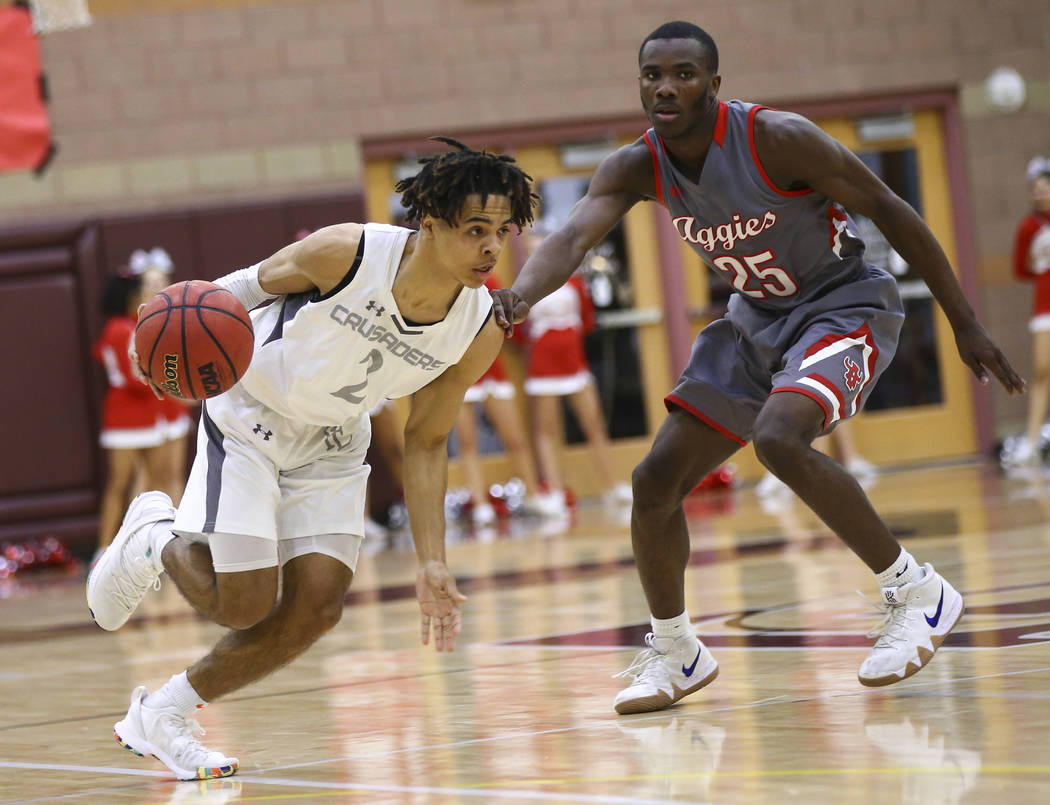 Faith Lutheran's Donavan Jackson (2) drives the ball against Arbor View's Larry Holmes (25) during the second half of a basketball game at Faith Lutheran High School in Las Vegas on Thursday, Jan. ...