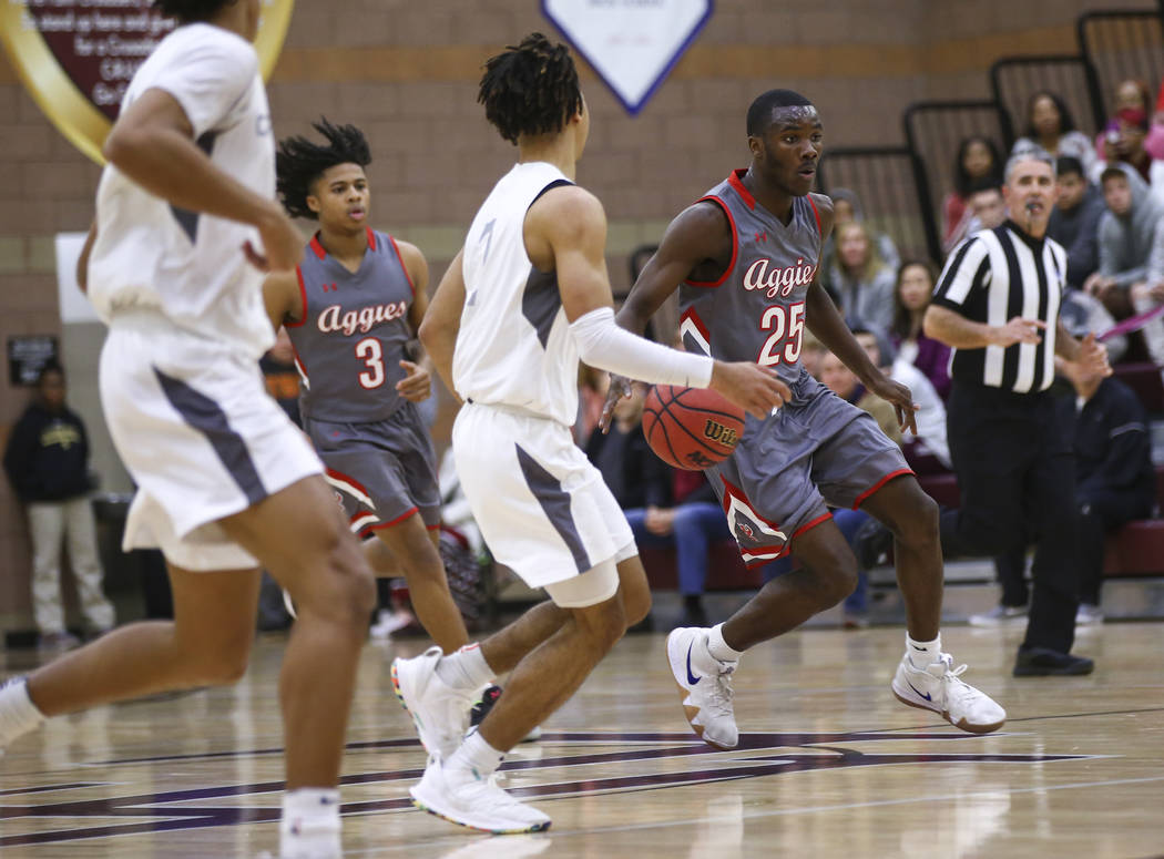 Arbor View's Larry Holmes (25) brings the ball up court during the first half of a basketball game at Faith Lutheran High School in Las Vegas on Thursday, Jan. 31, 2019. (Chase Stevens/Las Vegas R ...