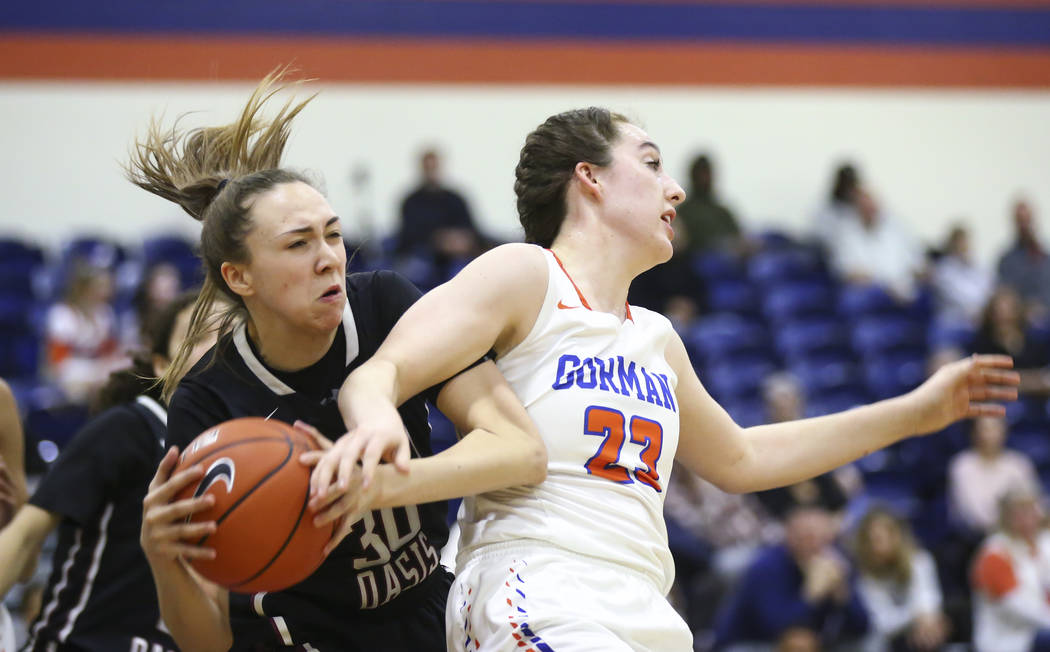 Desert Oasis' Sierra Mich'l (30) gets a rebound over Bishop Gorman's Tierney Holcombe (23) during the first half of a basketball game at Bishop Gorman High School in Las Vegas on Friday, Feb. 1, 2 ...