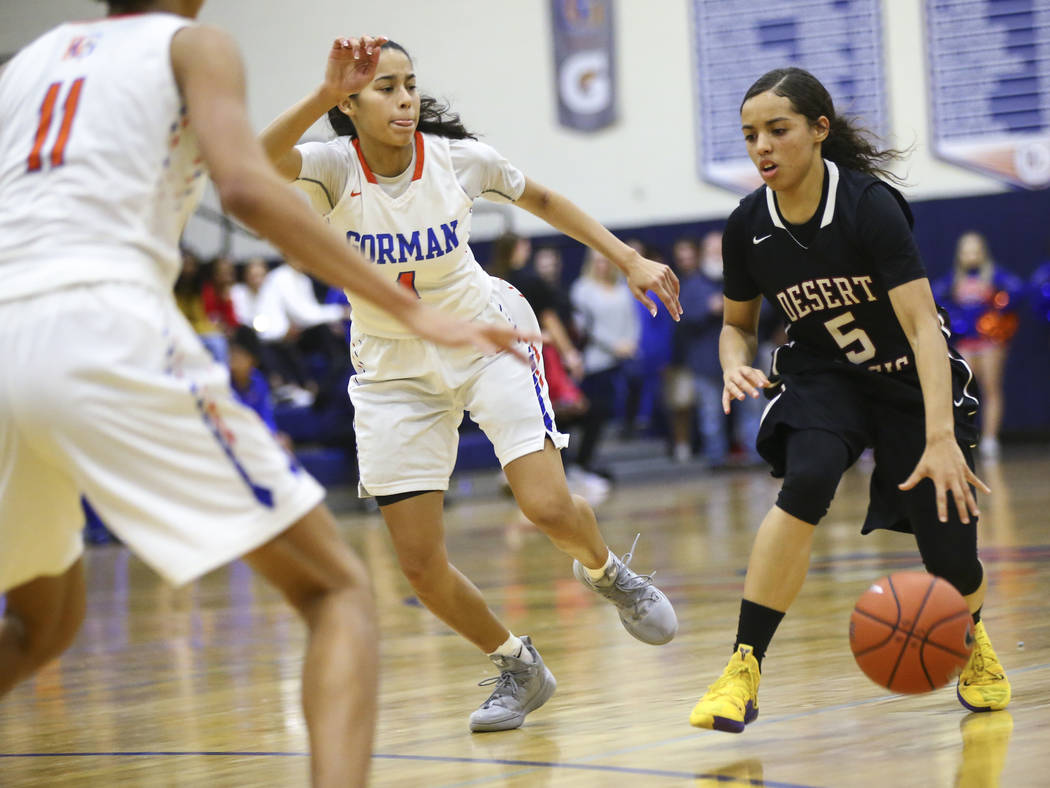 Desert Oasis' Eliyjah Pricebrooks (5) drives against Bishop Gorman's Caira Young (1) during the second half of a basketball game at Bishop Gorman High School in Las Vegas on Friday, Feb. 1, 2019. ...