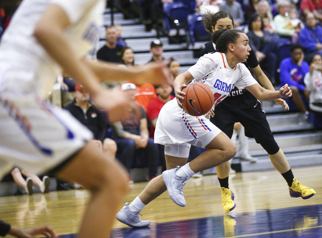 Bishop Gorman's Bentleigh Hoskins (24) drives the ball past Desert Oasis' Eliyjah Pricebrooks (5) during the second half of a basketball game at Bishop Gorman High School in Las Vegas on Friday, F ...