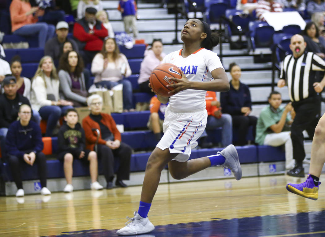 Bishop Gorman's Aaliyah Bey (12) drives to the basket against Desert Oasis during the first half of a basketball game at Bishop Gorman High School in Las Vegas on Friday, Feb. 1, 2019. (Chase Stev ...